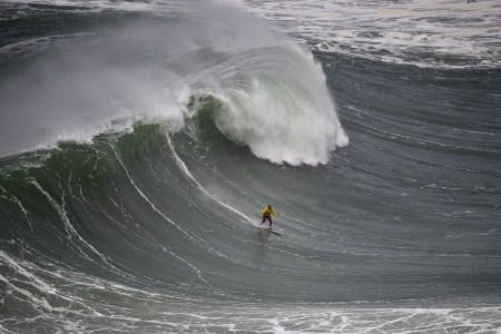 Garrett McNamara rides a wave at Praia do Norte in Nazaré in 2014