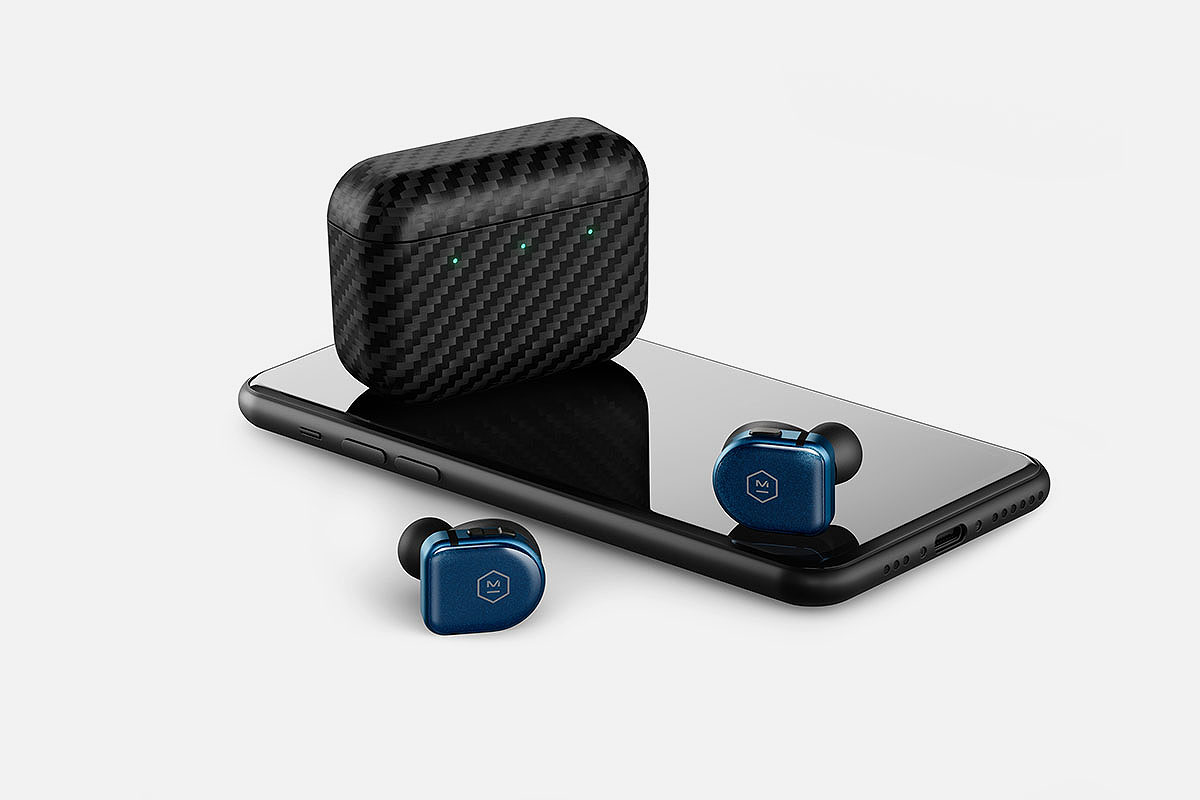 MW08 earbuds sitting on an iPhone