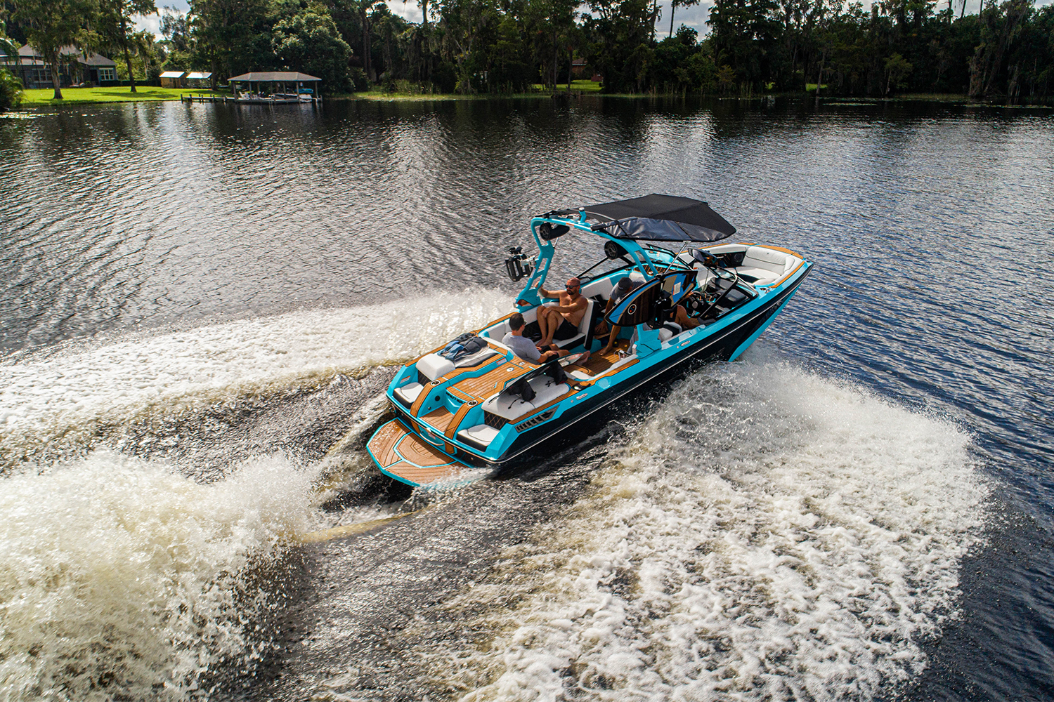The Super Air Nautique GS22E, an electric towboat from Correct Craft, out on the water. It features technology from Watershed Innovations and Ingenity Electric.