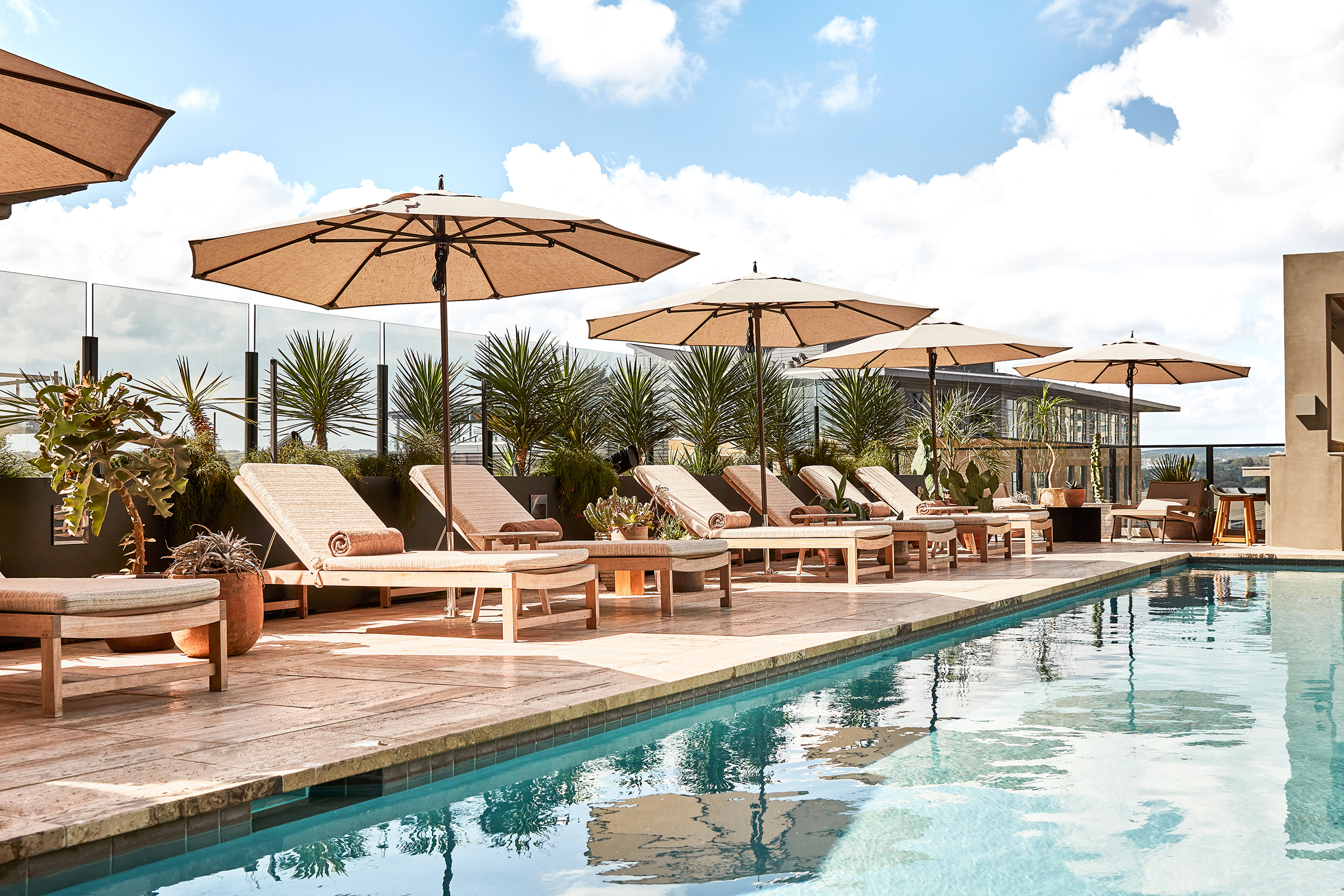 the rooftop pool at la piscina at the austin proper hotel