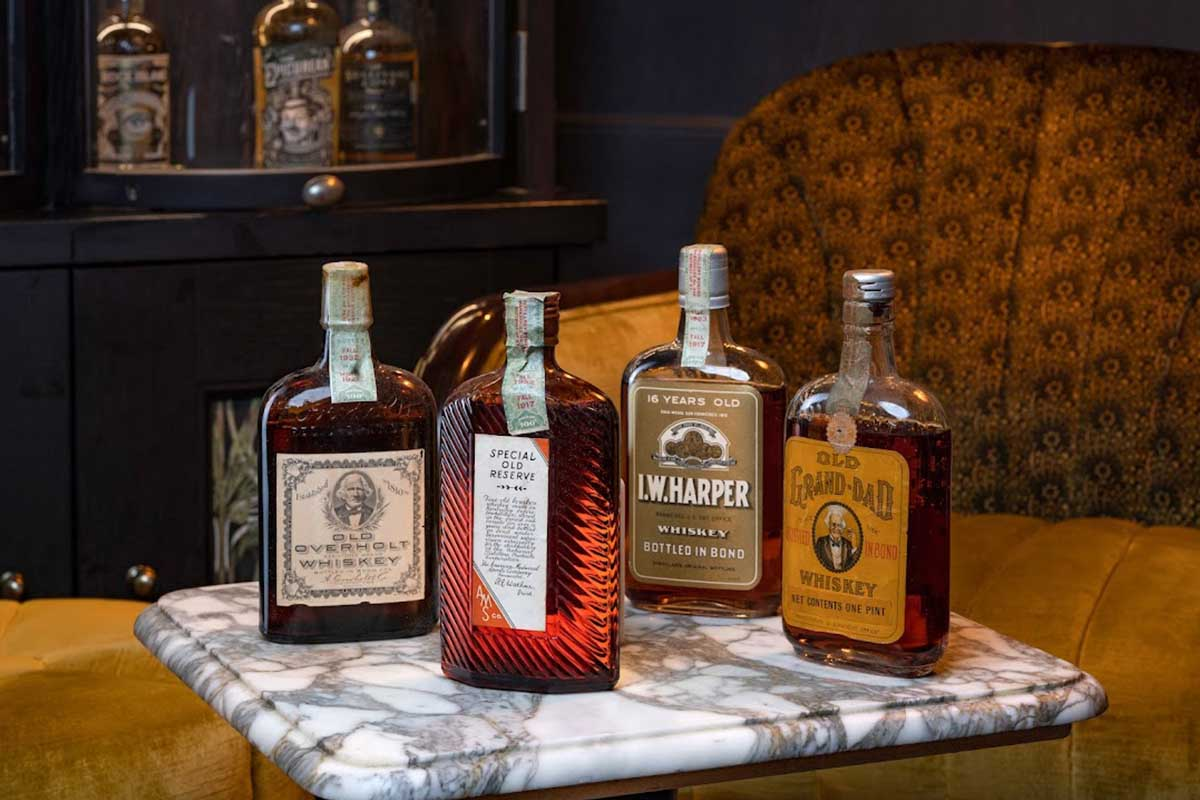 Prohibition Era whiskeys representing a unique time in American history (Old Overholt, Harry E. Wilken, I.W. Harper and Old Grand-dad)