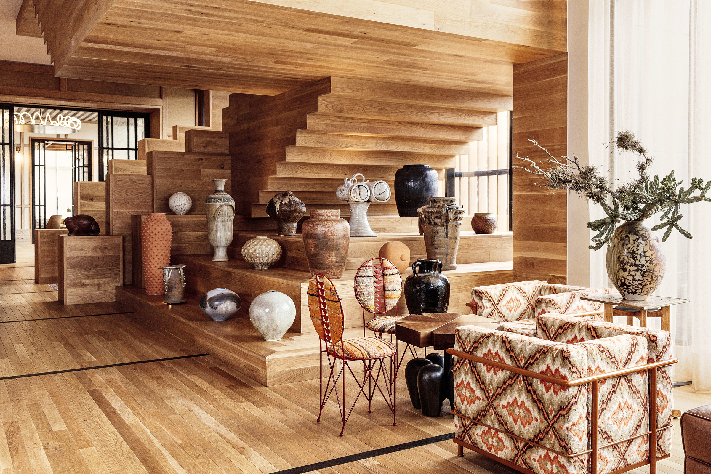 an installation of ceramics and vases in the lobby of the proper hotel in austin
