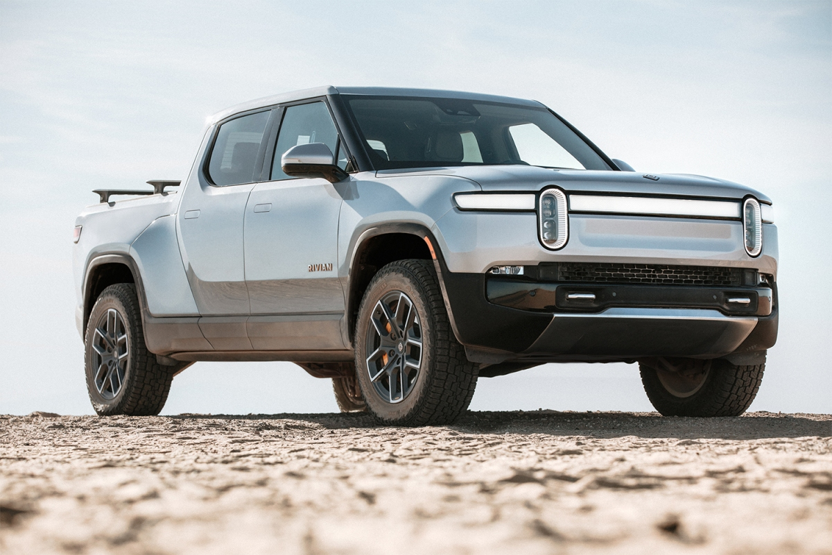 A silver Rivian R1T electric truck sitting still in the desert against a blue sky. The EV company is planning an IPO for November 2021.