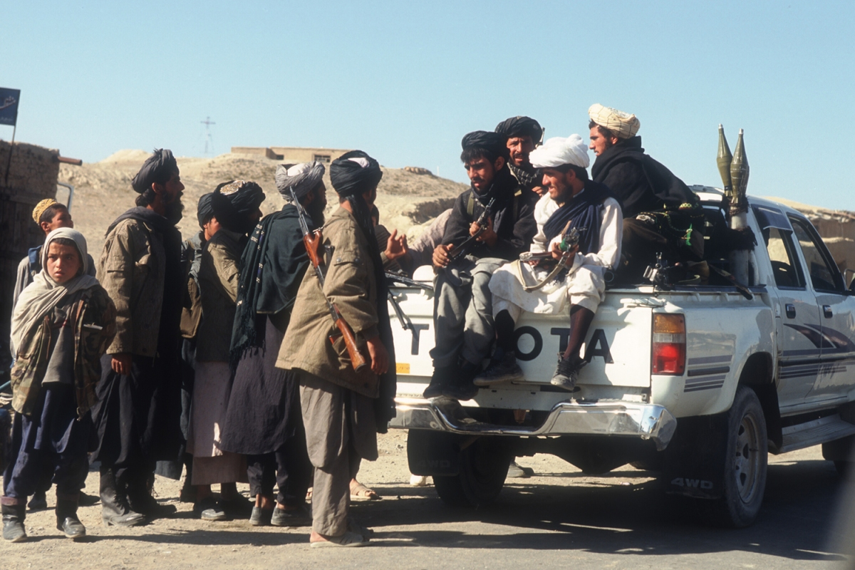 Taliban rebels with a Toyota pickup truck near Bagram Air Base on October 18, 1996. The Islamic group has a history of fighting with Toyota pickup trucks and SUVs, highlighted by their Afghanistan takeover in August 2021.