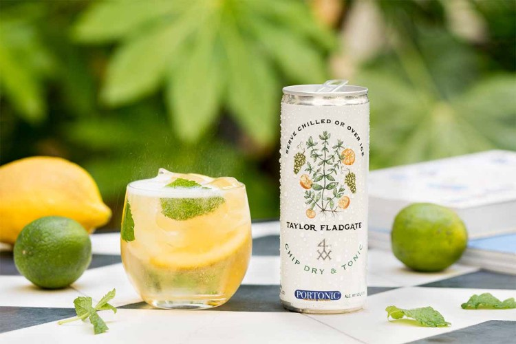 Taylor Fladgate Chip Dry & Tonic in a can, poured into a glass with mint and ice
