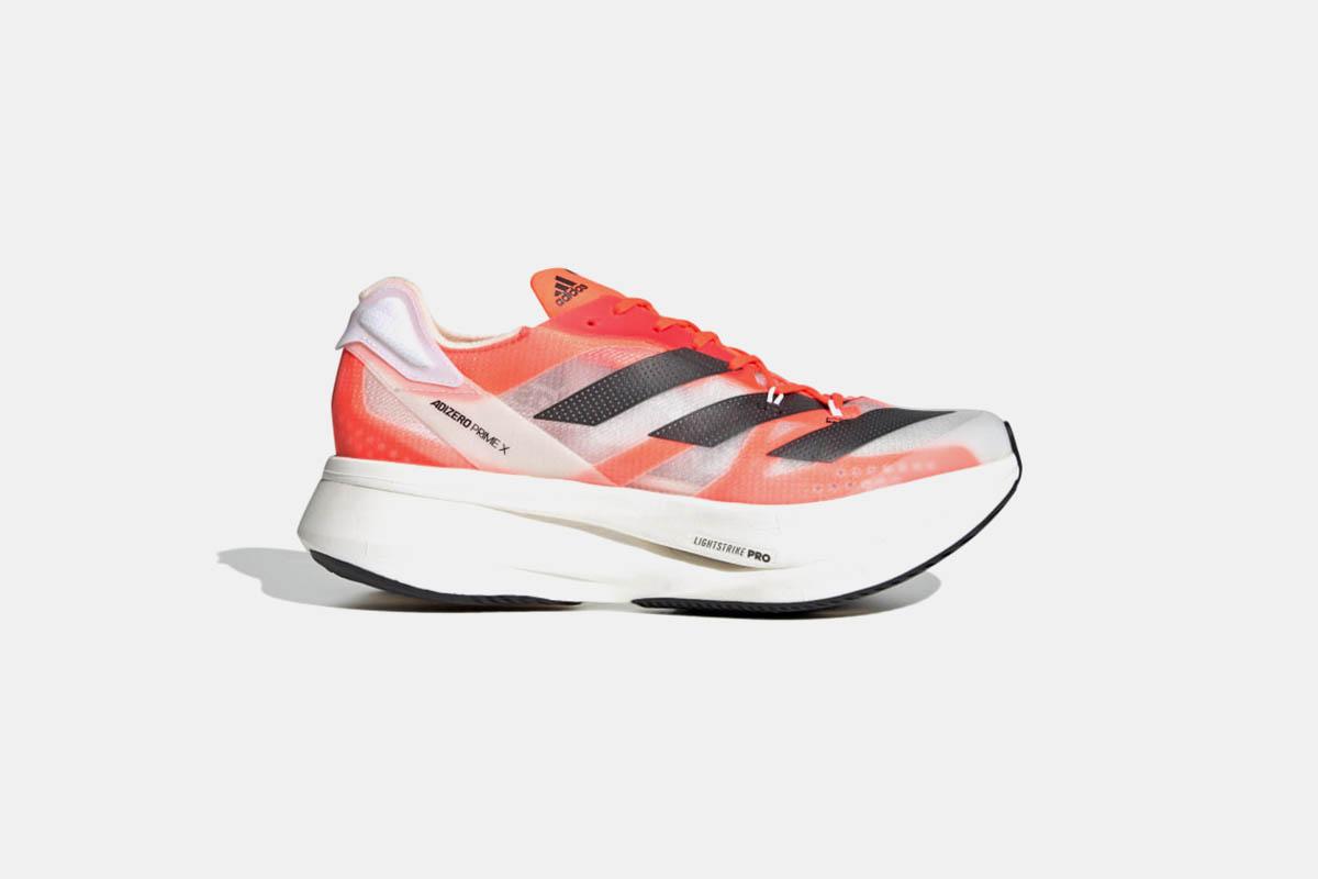 A pair of Adidas Adizero Prime X running shoes.