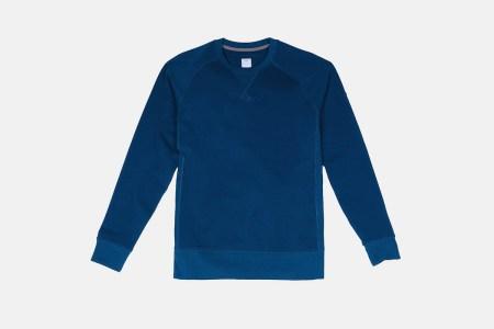 A blue activewear sweatshirt made by Myles Apparel.