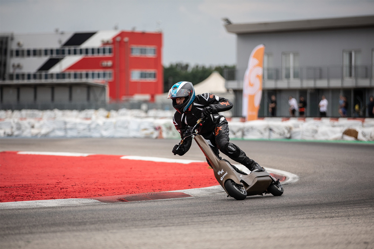 A man rides an electric scooter on a racetrack, testing for the new eSkootr Championship