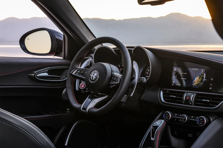 The interior of the 2021 Alfa Romeo Giulia Quadrifoglio, including the steering wheel, shifter and dashboard