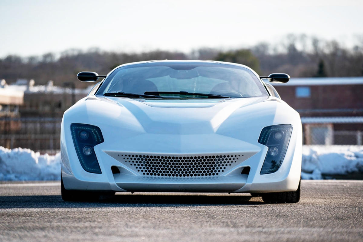The front end of the Bertone Mantide, a supercar built from a Corvette C6, painted in white instead of the original red
