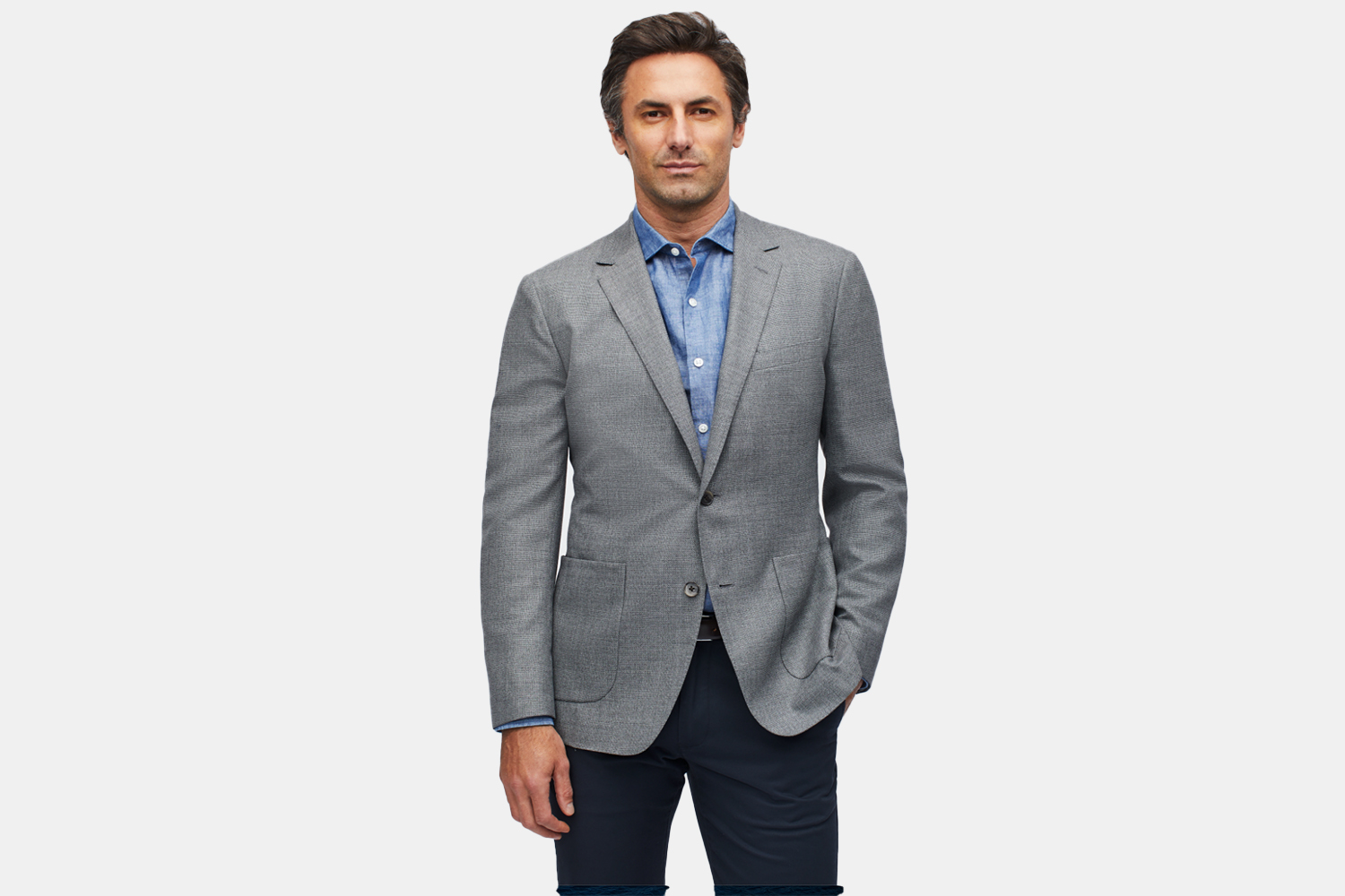 a man in a grey suit jacket