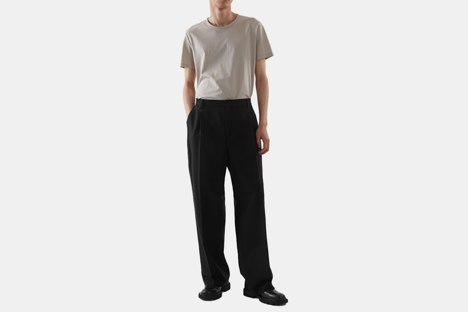 A model in a pair of wide legged black pants.