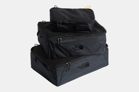 Close zoom The incredibly light Flyweight cube package includes small, medium and large Flyweight cubes that keep your clothes, gear and tech organized while you explore the globe. The North Face Flyweight Cube Package