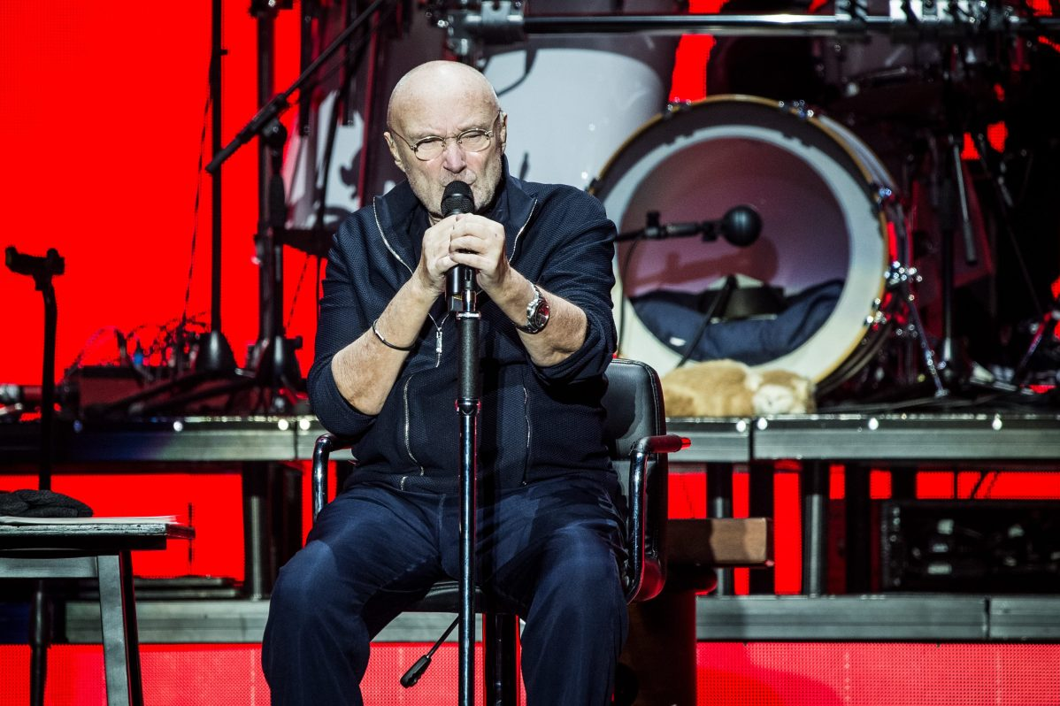 Phil Collins performs live on stage for the Italian date of his Still Not Dead Yet Live tour 2019. He currently cannot drum and sits during his concert performances.