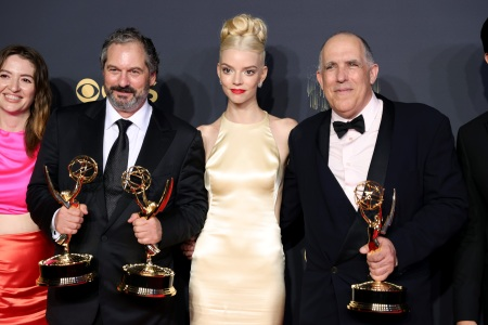 """(L-R) Marielle Heller, Scott Frank, Anya Taylor-Joy, and William Horberg, winners of the Outstanding Limited Or Anthology Series award for """"The Queen's Gambit,"""" pose in the press room during the 73rd Primetime Emmy Awards."""