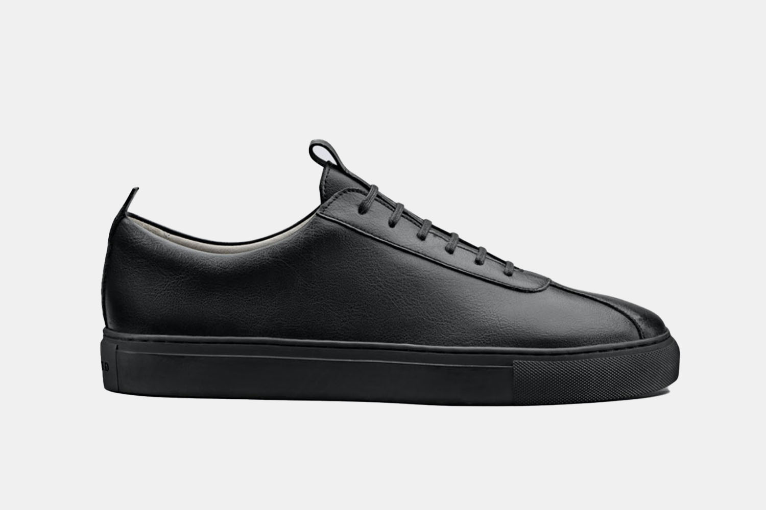 An all black leather sneaker.