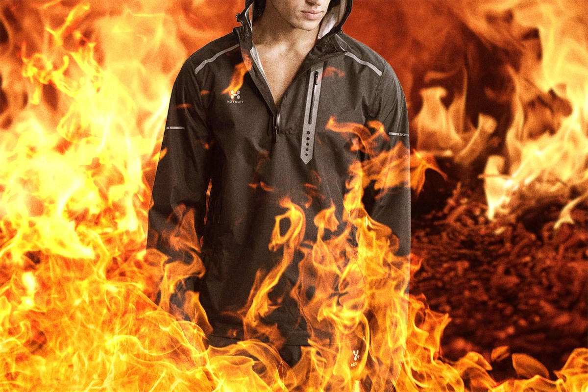 A man wearing a HOTSUIT and covered in flames.