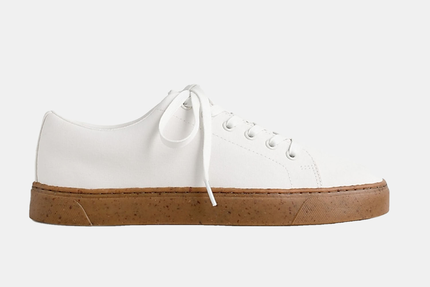A very white sneaker with a gum sole.