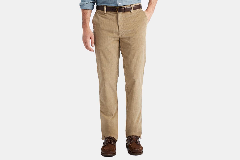 a model in a pair of tan corduroy pants.