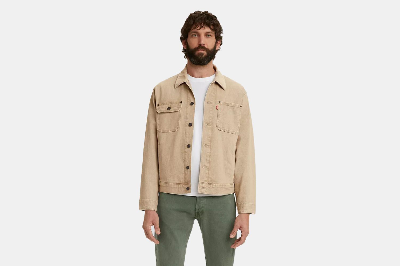 a model In a tan levis trucker jacket