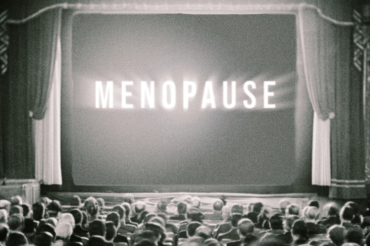 A theater screen with the words menopause writes across it.