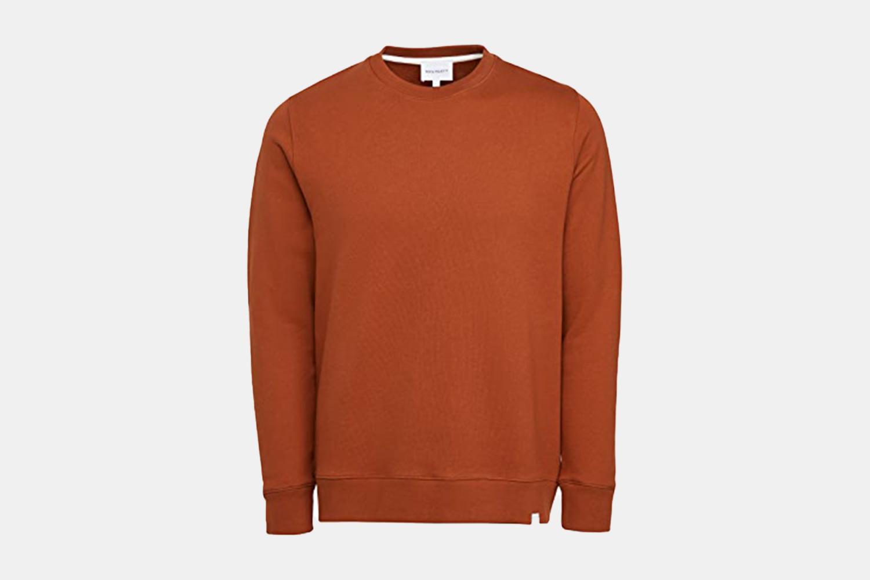 A burnt orange crewneck sweater