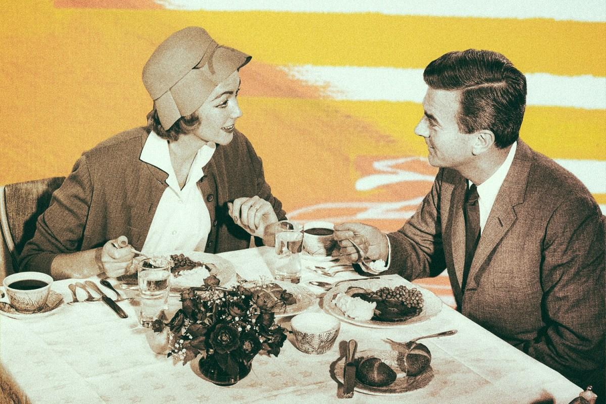Black and white photos shows a circa-1920s couple at a restaurant