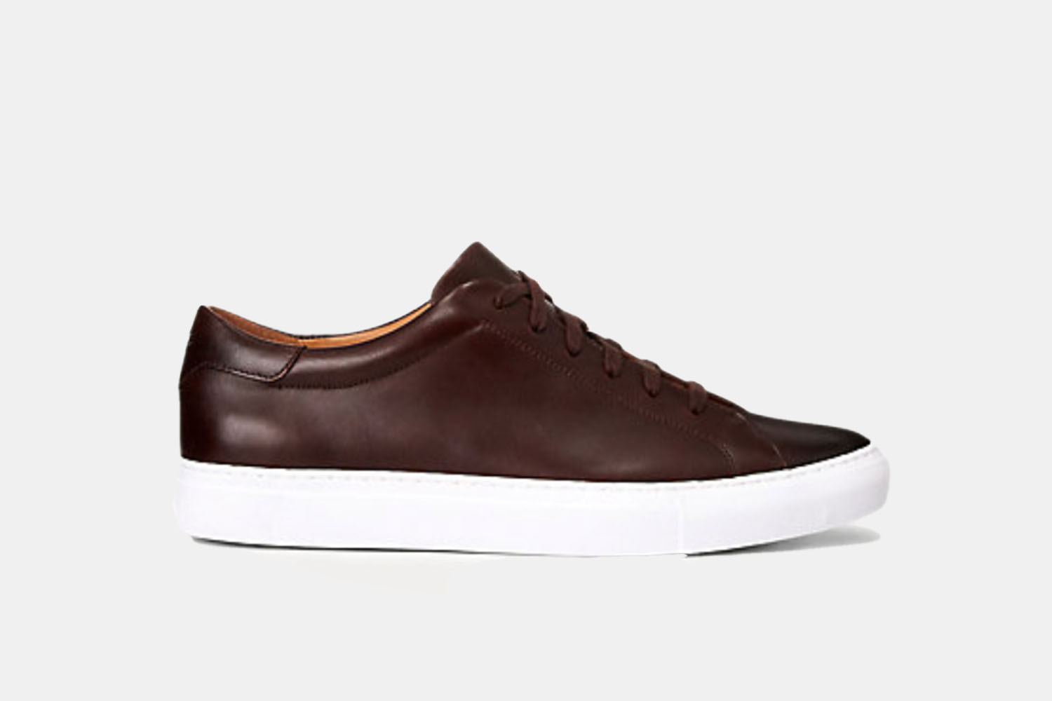 A dark brown leather and white soled sneaker.