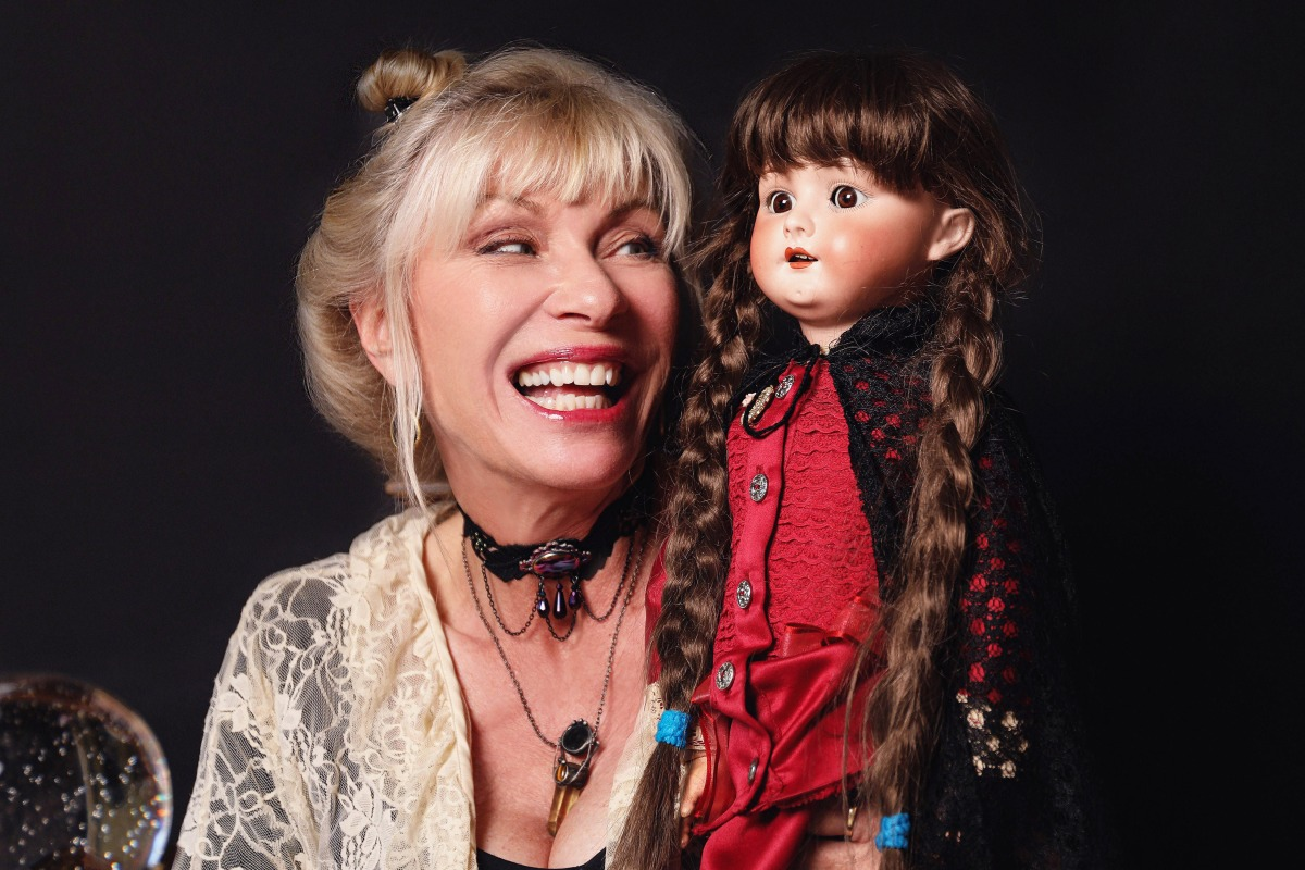 hollywood with patti negri holds a porcelain doll with braided hair
