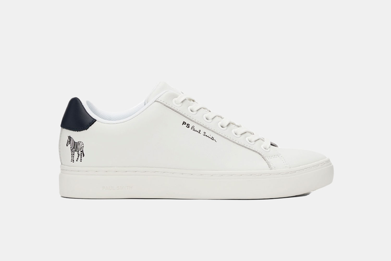 A white sneaker with blue accents and a zebra on the back right corner.