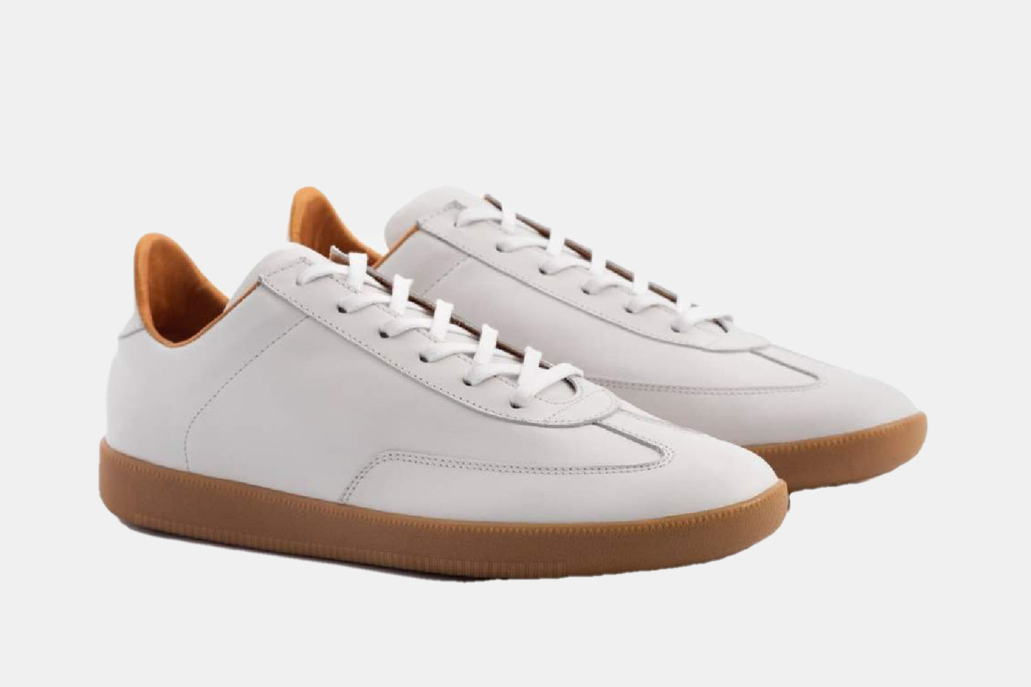 A white and gum soled sneaker.