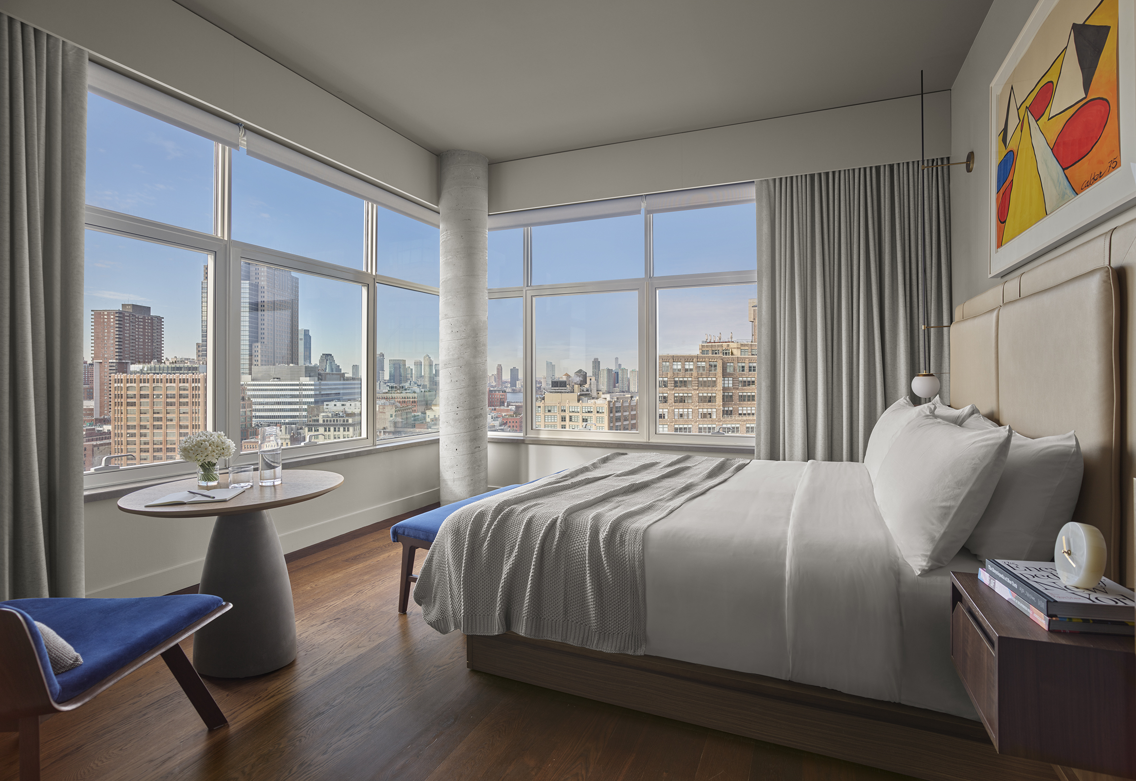 A Skyline King studio at the ModernHaus hotel in Soho, Manhatatn with king size bed, breakfast table and views of lower manhattan