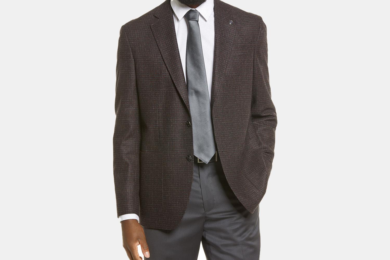 an unbuttoned brown blazer