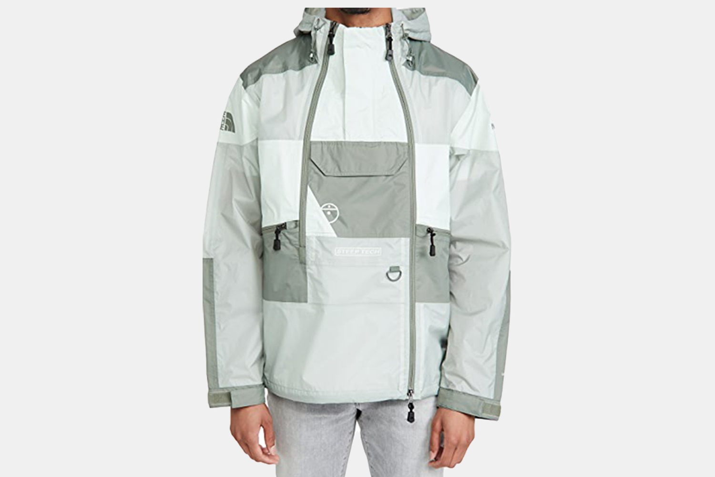 a grey patterned rain jacket.