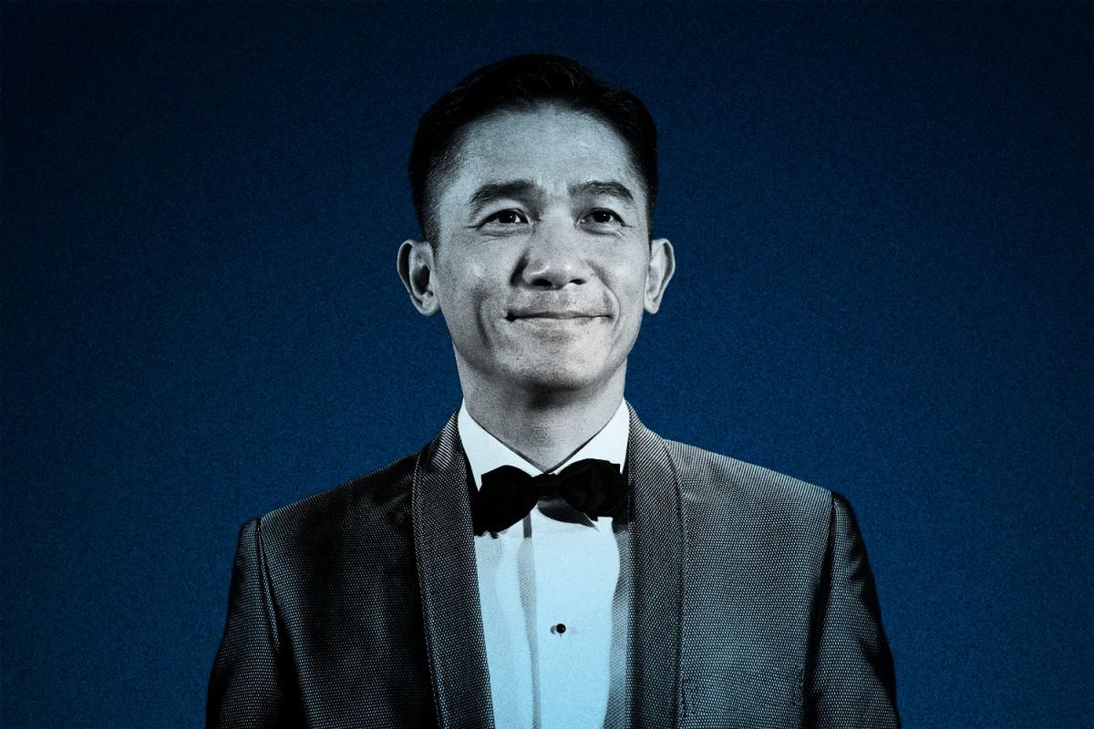hong kong actor tony leung chiu-wai wears a black suit and bow tie