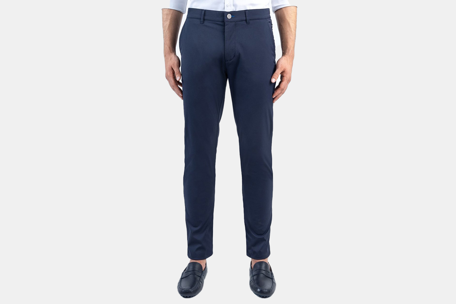 a pair of navy pants on a model.