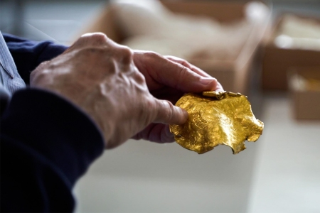 A man holding a piece of Iron Age gold found by Danish rookie treasure hunter Ole Ginnerup Schytz and to be exhibited at the Vejlemuseerne in Denmark