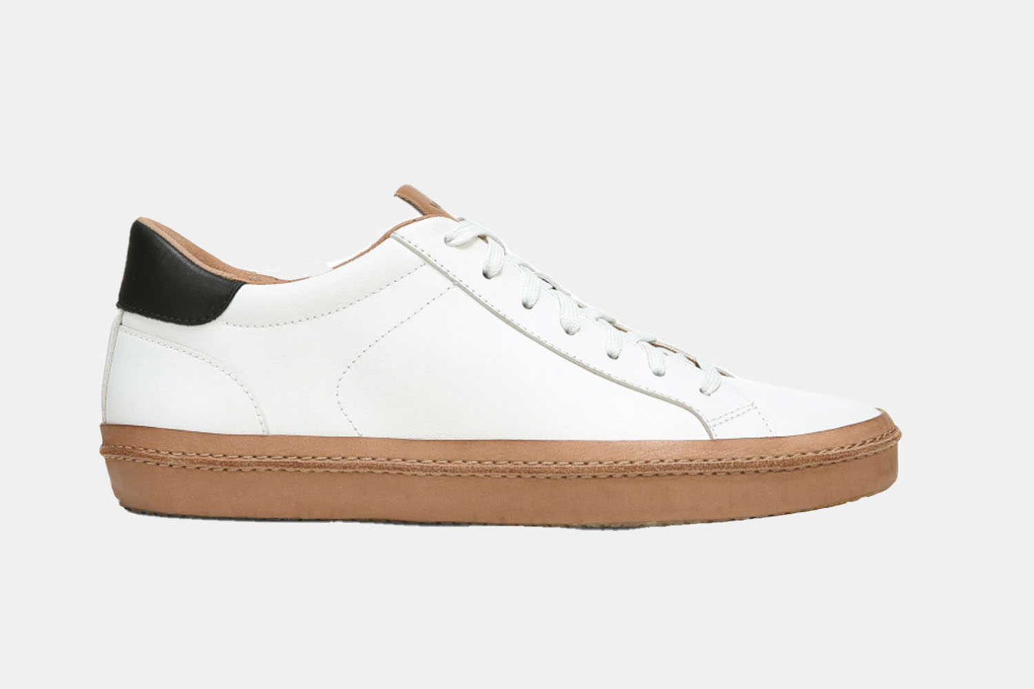 a white sneaker with a blue accent and gum sole.