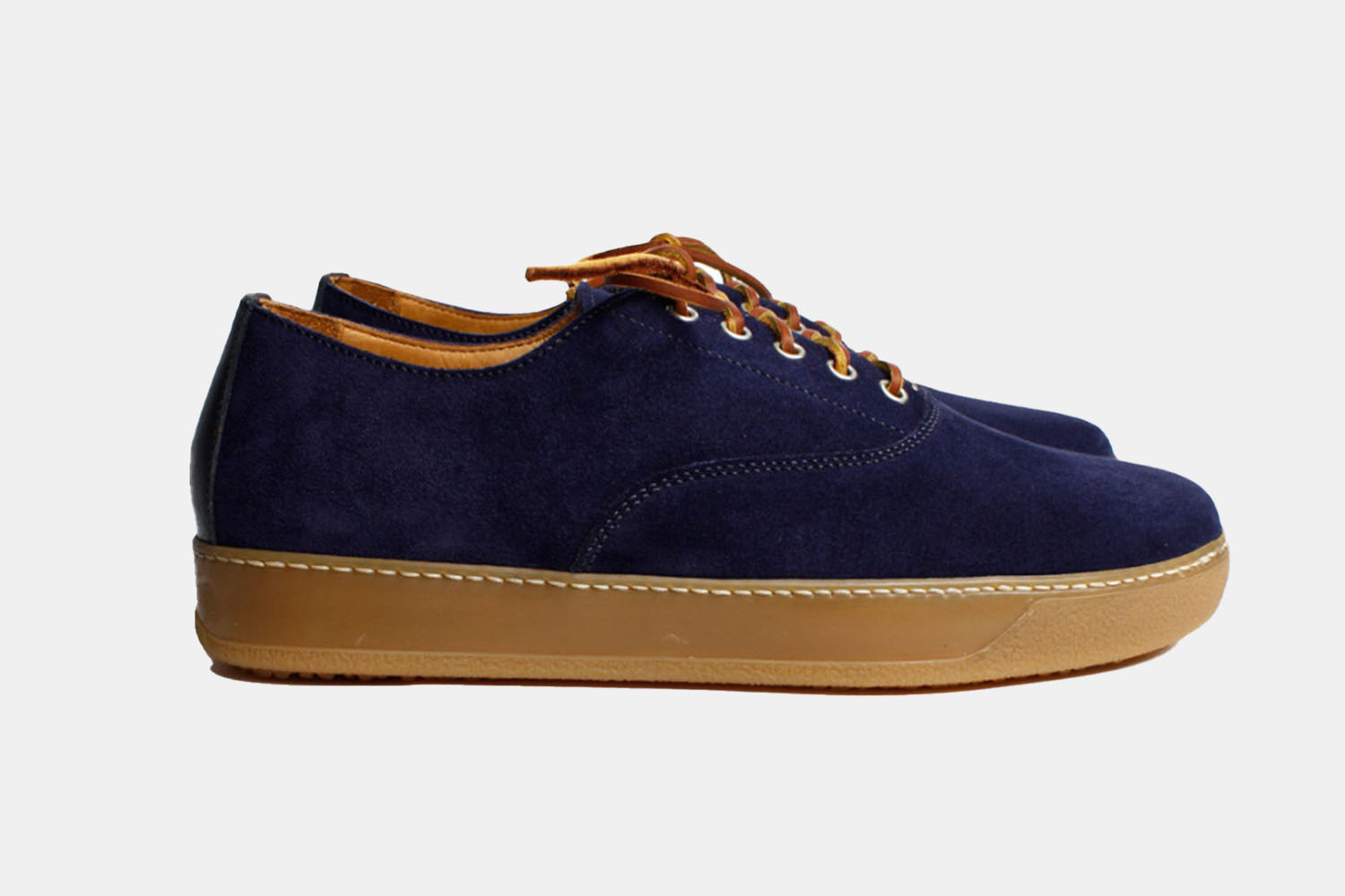 A navy suede sneaker with a gum sole.