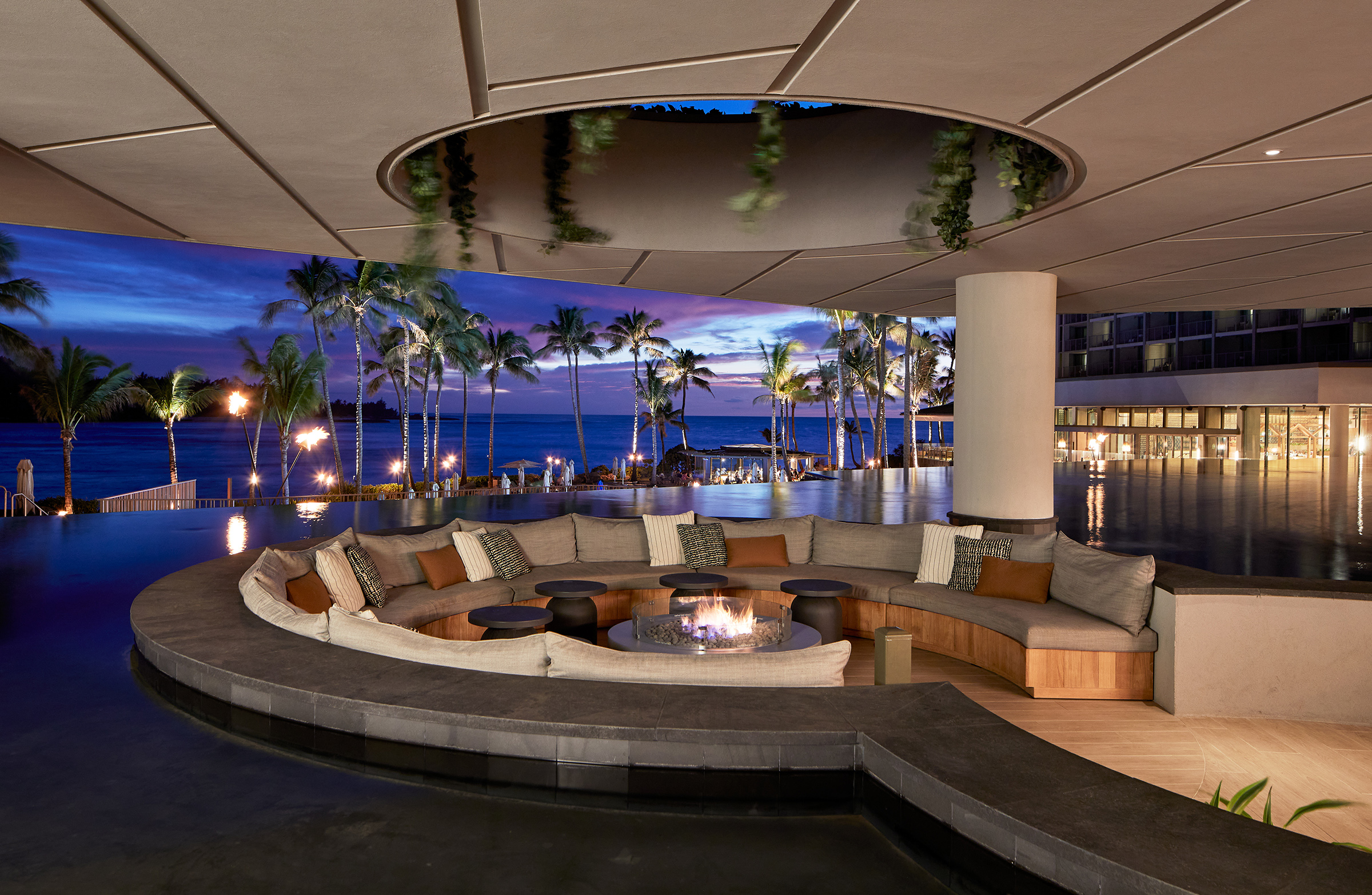 a fire pit and cushioned seating at the Off the Lip lobby bar at the Turtle Bay Resort in Oahu