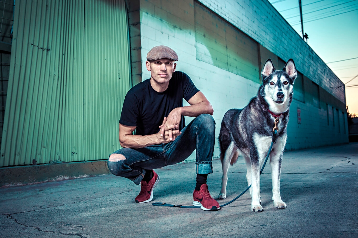 """""""Dog Impossible"""" host and The Zen Dog founder Matt Beisner with a husky"""