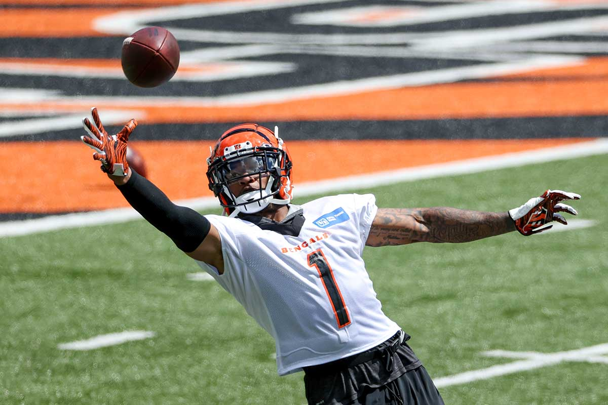 Ja'Marr Chase #1 of the Cincinnati Bengals participates in a drill during Mandatory Minicamp on June 15, 2021 in Cincinnati, Ohio. The Bengals receiver has had issues with drops during the preseason.