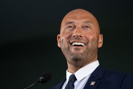 Derek Jeter smiles while delivering his remarks at the Baseball Hall of Fame Induction Ceremony at the Clark Sports Center on September 8, 2021 in Cooperstown, New York