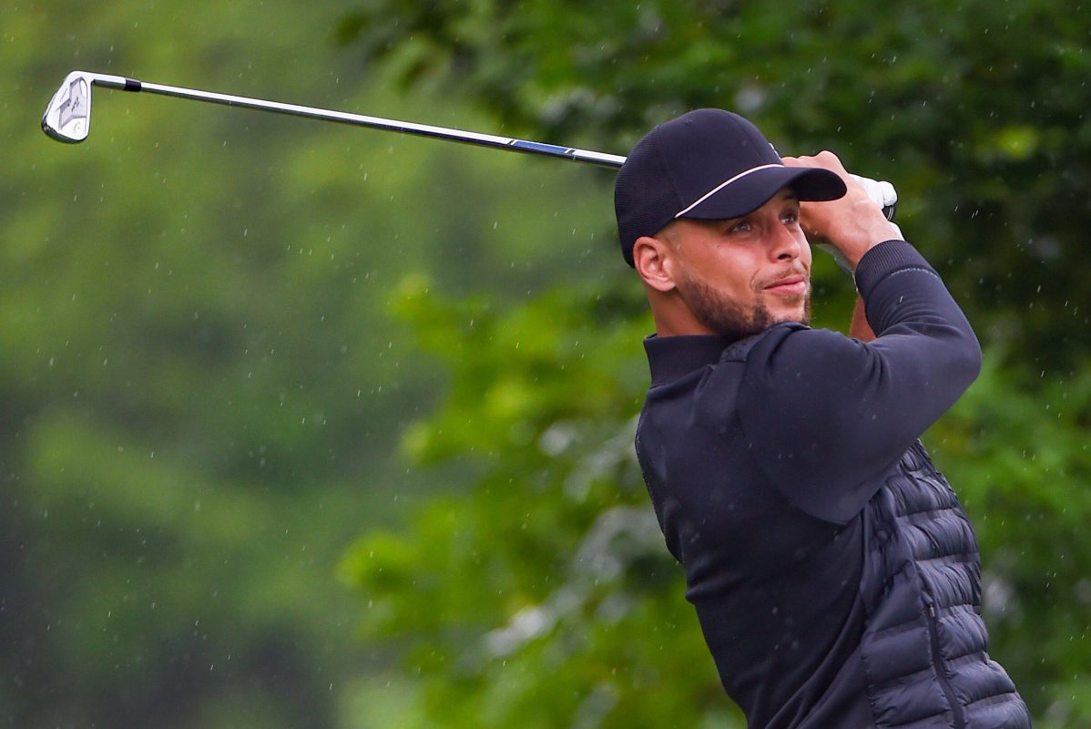 Steph Curry watches his tee shot at Muirfield Village Golf Club in Ohio