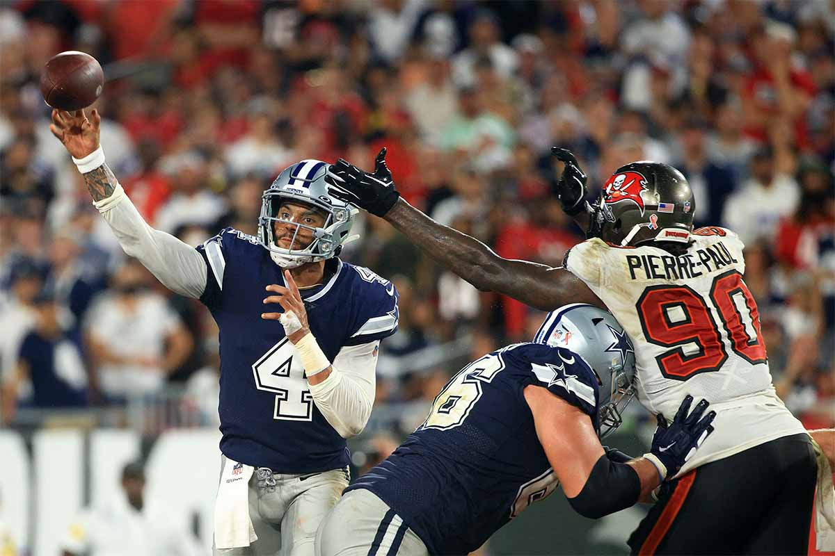 Dak Prescott #4 of the Dallas Cowboys passes while pressured by Jason Pierre-Paul #90 of the Tampa Bay Buccaneers during the third quarter at Raymond James Stadium on September 09, 2021 in Tampa, Florida. Prescott's impressive performance shouldn't be overshadowed by a last-second loss.
