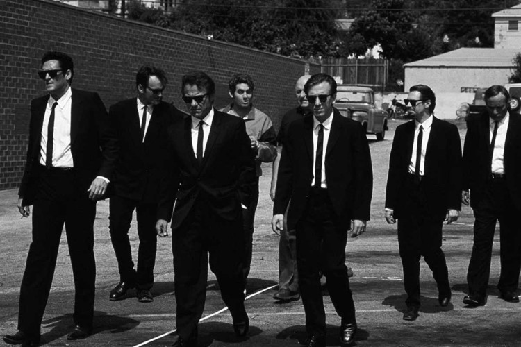 """The characters from """"Reservoir Dogs"""" dressed in black suits, white shirts and black ties"""