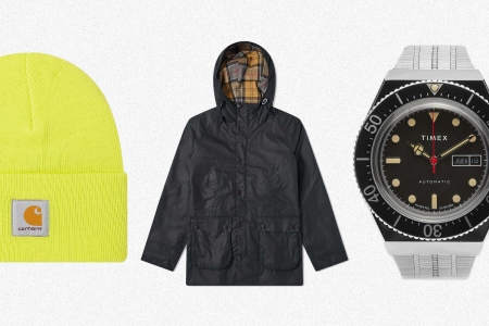 A neon yellow watch cap from Carhartt WIP, a Barbour Bedale waxed jacket with a hood and an M79 automatic watch from Timex, all on sale at End Clothing in September 2021