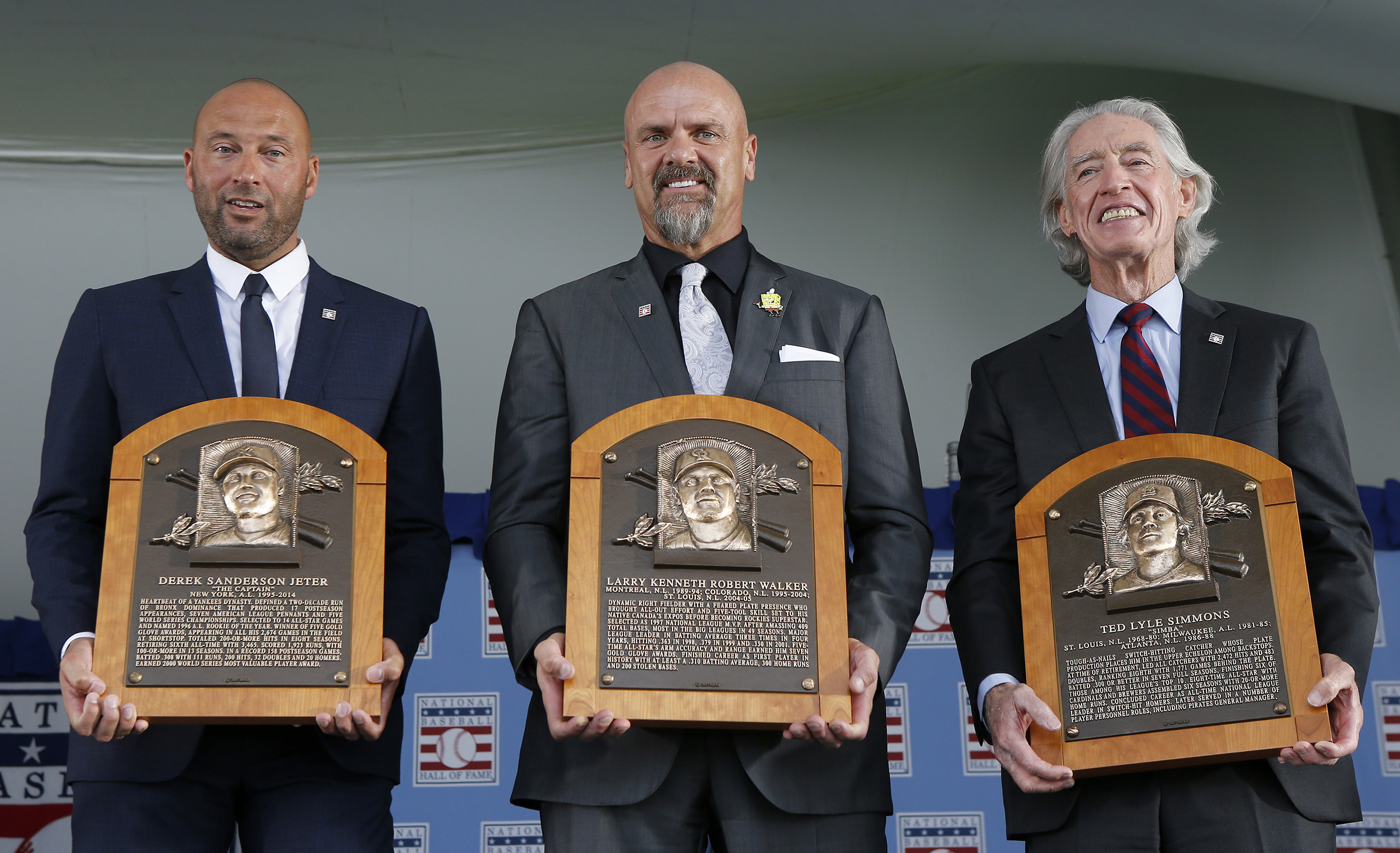 Derek Jeter, Larry Walker and Ted Simmons pose for a photograph with their plaques during the Baseball Hall of Fame induction ceremony at Clark Sports Center on September 08, 2021 in Cooperstown, New York