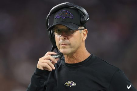 Head coach John Harbaugh of the Baltimore Ravens watches a game. Thanks to Harbaugh's fourth-down call, the Ravens finally beat the Chiefs.