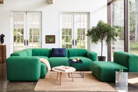 A Mags Soft Low Sectional Sofa from Hay Design in green as the centerpiece in a well-lit living room